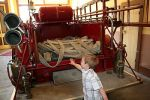 Sam checking out the old firetruck in the old fire station.