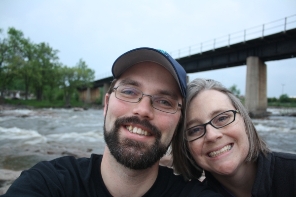 In the evening we went back to Falls Park just for a bit. Mostly I climbed around on the rocks while Art took pictures of water, but he did let me be in this one. :)